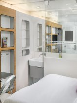 YOTELAIR Premium Cabin with pullout desk