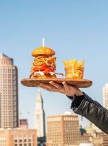 YOTEL Boston burger and fries with the Boston skyline