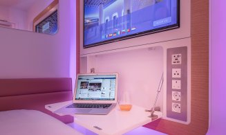 YOTELAIR Paris CDG pullout desk with laptop