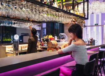 YOTEL Singapore - Hops & Grains bar with guest