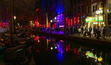 Busy street at night in Amsterdam