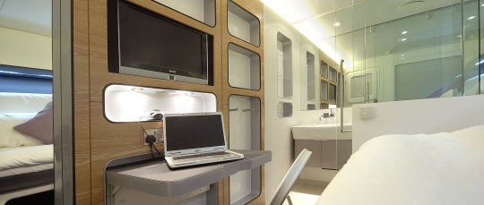 YOTELAIR Premium Cabin with laptop white